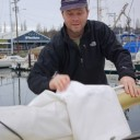Cap'n Van removes the mainsail cover