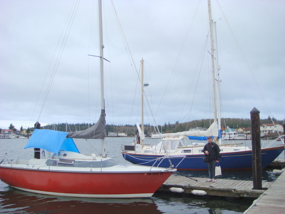Van standing between his former boat and his new boat