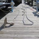 The anchor and all chain rode, laid out on the dock for inspection.