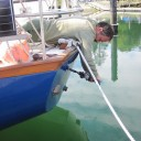 Van drilling another hole in the boat, this time in the transom to put in the new outlet for our maintenance bilge pump.