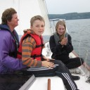 Lianne with Max on her lap, and Chris on the foredeck, enjoying the fruits of the labor while we were underway