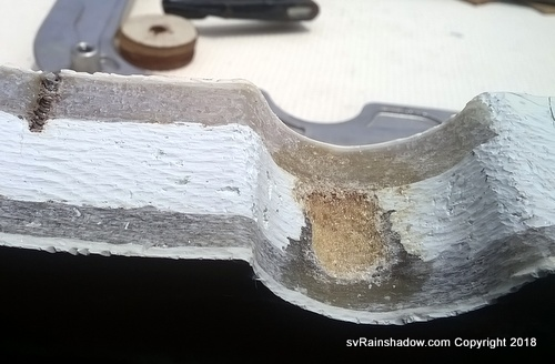 Cross-section of head window opening after grinding exposed the inner foam core